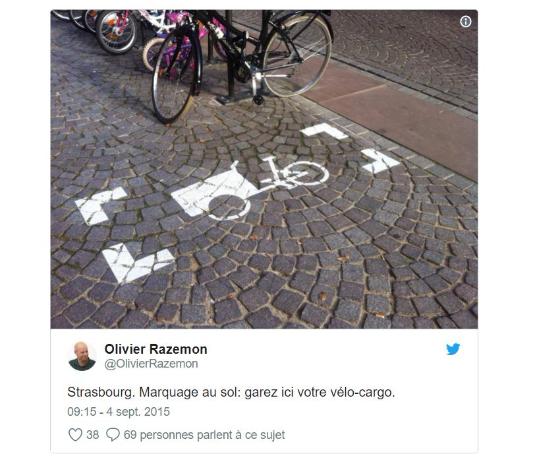 Twit montrant un marquage au sol pour le stationnement d'un vélo cargo à Strasbourg