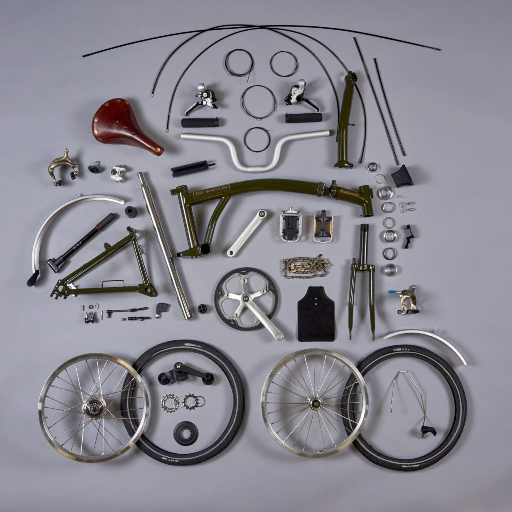 Vélo pliant Brompton présenté en pièces détachées